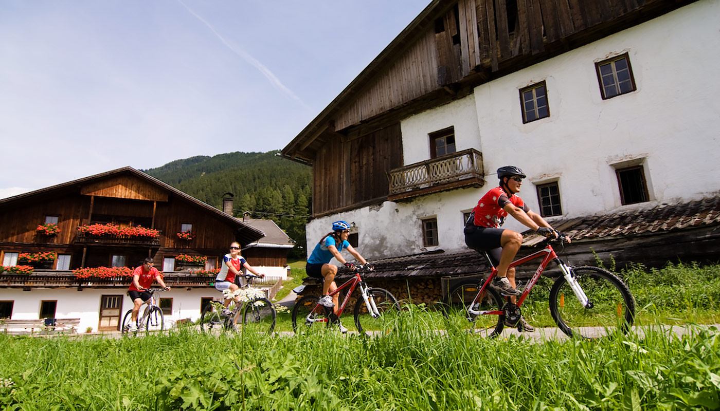 a group of cyclists departs from Hotel Tannenhof