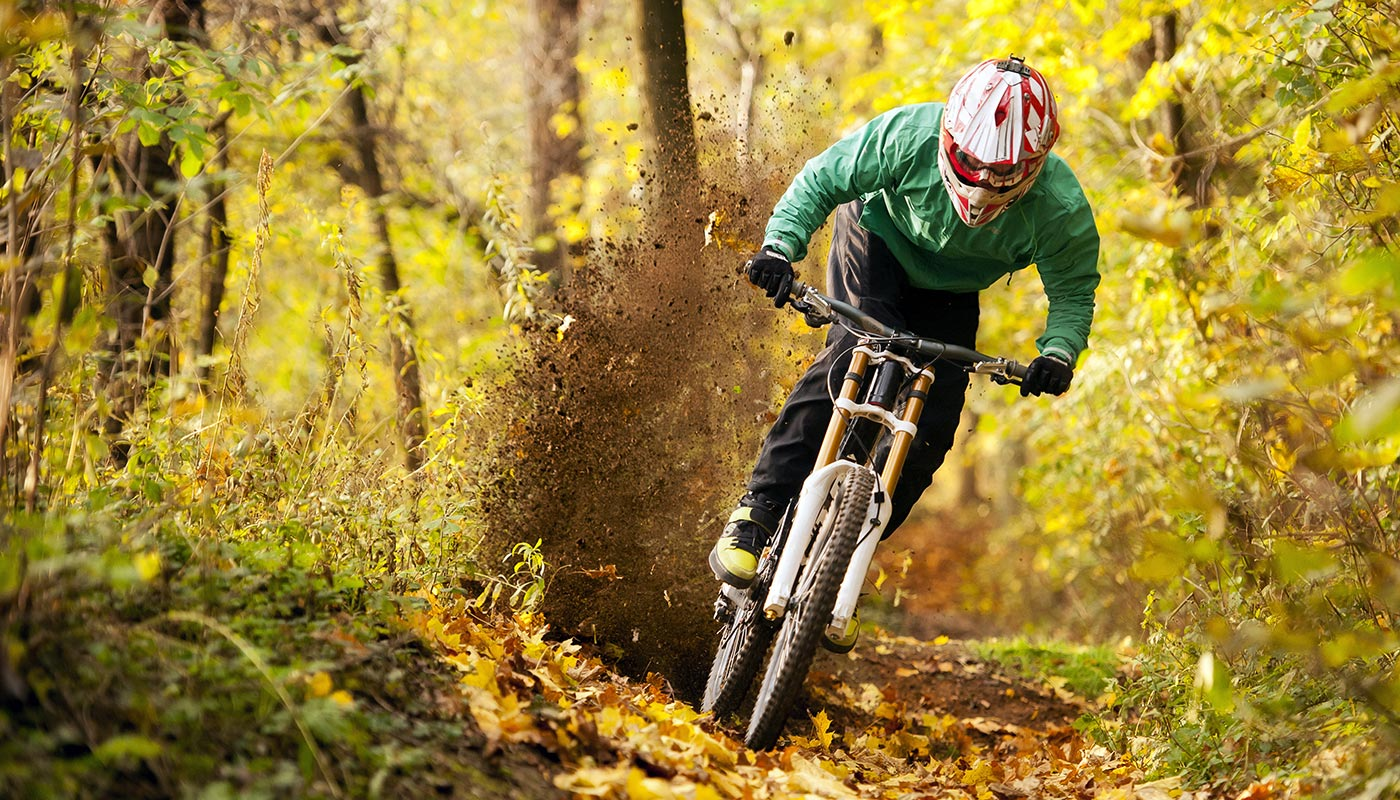 a guy is riding his mountainbike downhill