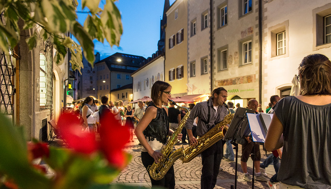 Musicians play on the street during a party in Bruneck