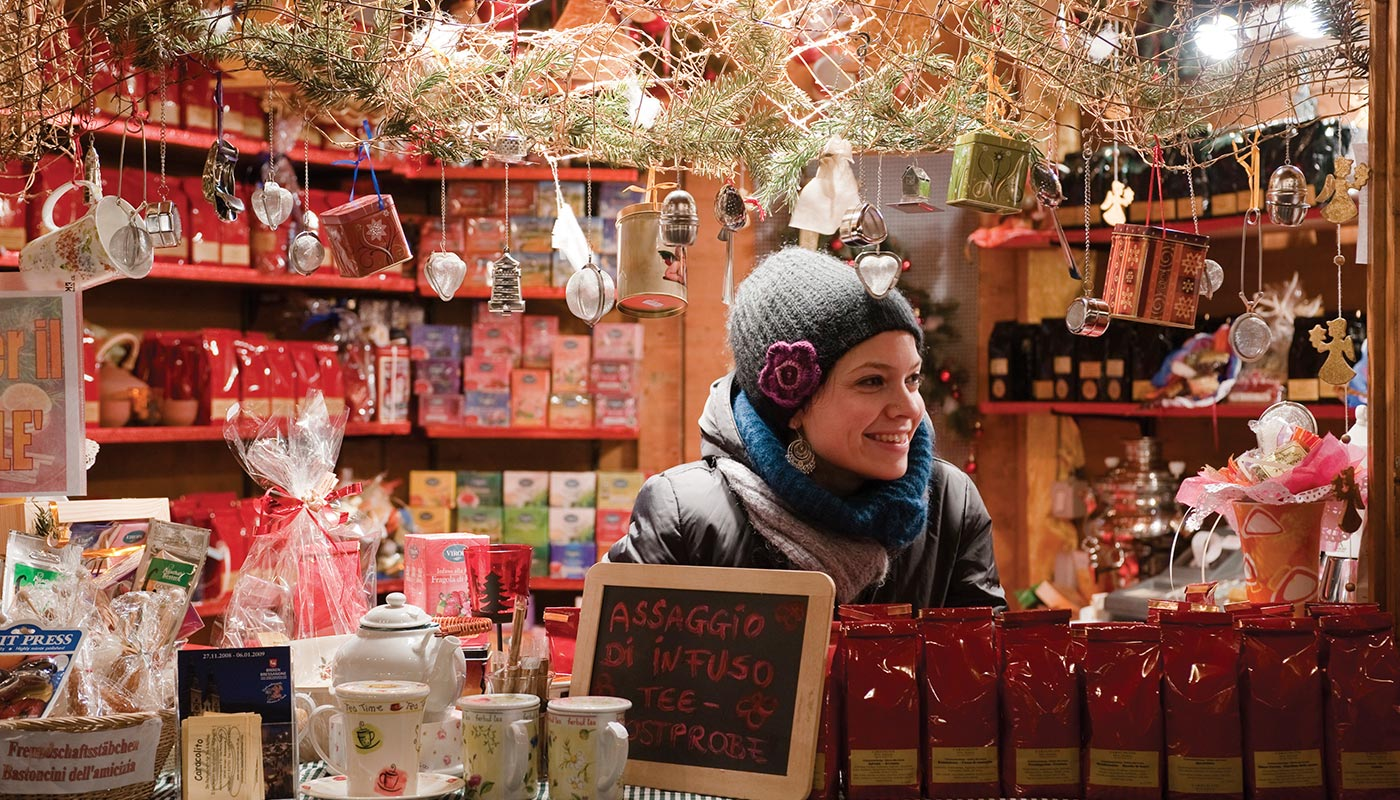 A girl sells typical products during the Christmas market
