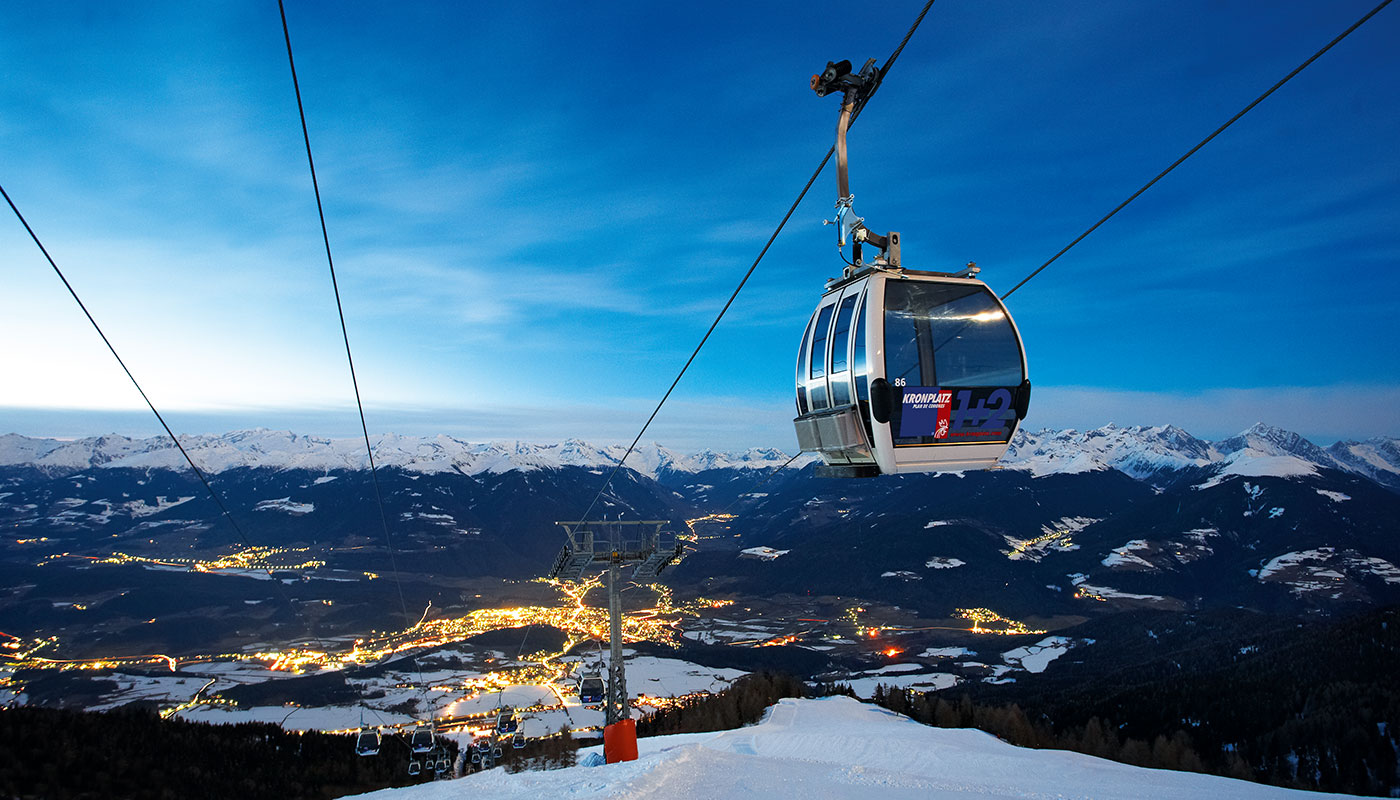 View over Bruneck from the ski lift at Kronplatz in the evening