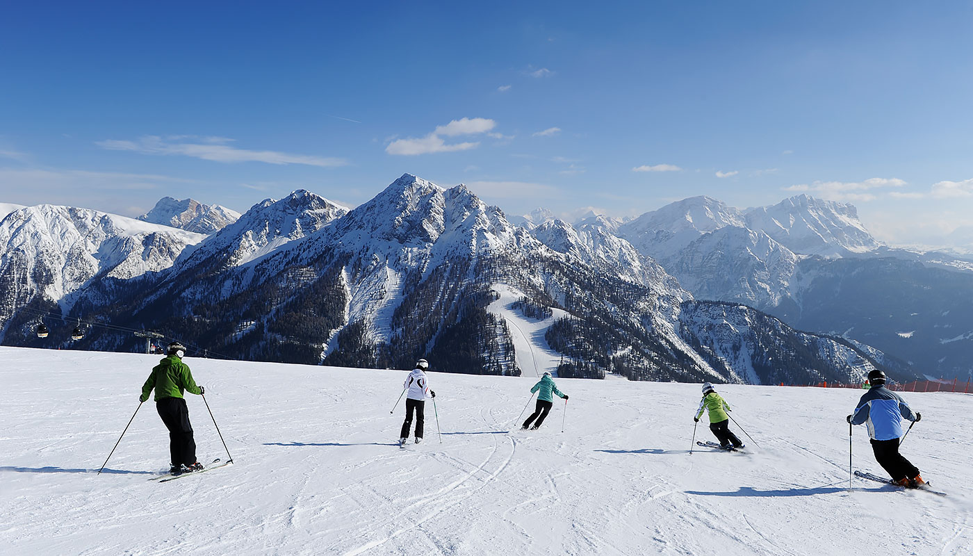Skiers on the slopes in winter at Kronplatz
