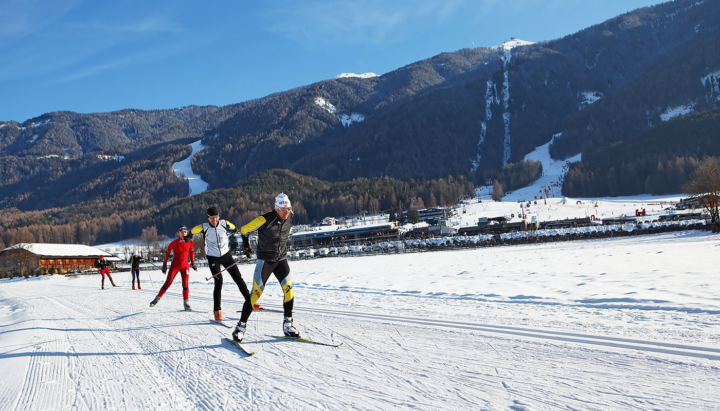 some gentlemen at the cross-country skiing on Kronplatz