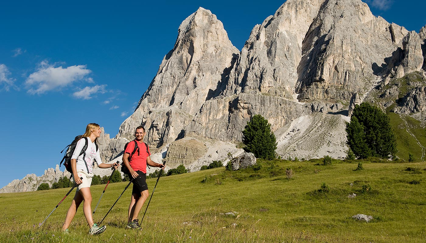 a couple during Nordic Walking on the mountain near Bruneck